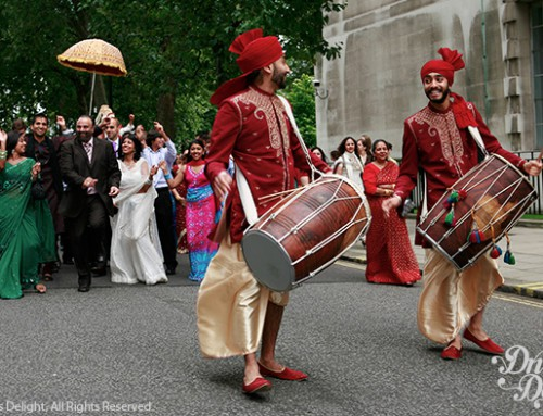 Dhol Players in Red Dhoti Costume